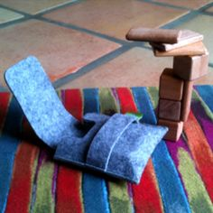 'Click- Clack' Magnetic Mahogany Blocks by Tegu: Thanks to @Rebecca Silbermann! Awesome clicking sound, feel great in the hand and wonderfully therapeutic for an endless flight. Packaged in a thick grey felt carrying case! #Tegu #Wooden_Blocks #Magnet