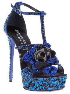 Blue spike satin heel sandal from Gianmarco Lorenzi featuring small blue and black crystals embellishment , platform and large blue and black satin flower detail. $3228.00.!