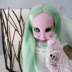 Emerald the Enchanting Witch is a very friendly chubby 6 1/2 inch tall doll with lavender skin and mint green hair. She debuted in 1972 from Milton...