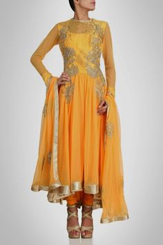 Intricately embellished with beads and crystals this orange anarkali is a stunning choice for high profile events. The pleated bodice is of...