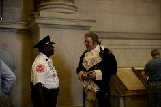 A security guard chats with a Founding Father on #July4 inside the National Archives.  Join us this year at 10 am: http://go.usa.gov/bypC