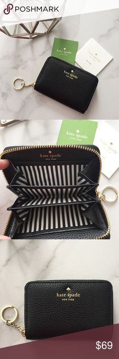 Kate Spade Cassidy keychain wallet Cute Kate Spade Cassidy wallet is brand new and never used! Has several inner pockets and a key ring attachment. kate spade Bags Wallets