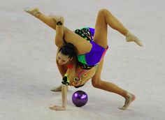 What exactly are we looking at?: Gold medallist China performs its exercise with three balls and two ribbons at the team final during the Rhythmic Gymnastics World Cup in Debrecen, Hungary on March 16, 2014. (Photo: Attila Kisbenedek/AFP/Getty Images)