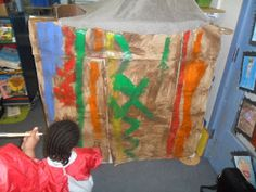 Handa's Surprise: Paint with mud and decorated role play corner to make a mud hut.