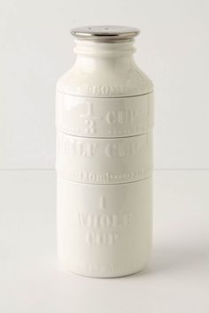 Milk Bottle Measuring Cups from Anthropologie.com -- got these for Christmas!