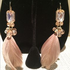 Champagne Emerald  feather earrings 4 Carat  Emerald cut Champagne Crystal and feather earrings. Gorgeous Nude colors. Definitely for a fancy occasion. Absolutely perfect for a wedding!  These will bring some Blingdom to your Kingdom!! Hand Made Jewelry Earrings