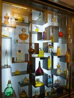 Inspired wall of classic perfume bottles - one of many displays in The Perfume Museum in Grasse   Inspiration-Mood-Dream board for the planning of The Mini Museum & Miniature Perfume Shoppe Gallery