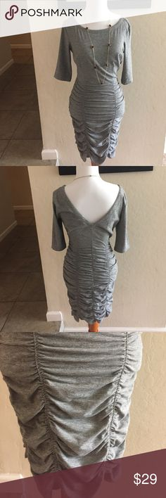 BCBGenerations dress with 3/4 sleeve size small v- cut in back. Gray and black striped. Super figure flattering. Excellent condition. BCBGeneration Dresses