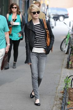 Emma Stone rocks casual street style in stripes, leather, greyed denim, and simple black flats.