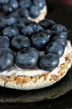 This is one of my favorite things to eat for breakfast or morning snack. I use one Light Laughing Cow cream cheese wedge. I split one high fiber 100 calorie Thomas Multi Grain English Muffin in half and toast them in a toaster. I divide the cream cheese to spread on both sides before placing blueberries on top.