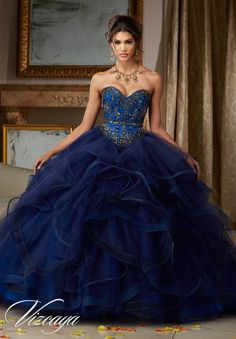 Tulle Quinceañera Ballgown with Ruffled Skirt. Beaded Bodice Features a Sweetheart Neckline and Corset Back. Colors Available: Navy/Royal, Scarlet/Pink Panther