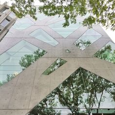 """"""" Reflections on the facade of Tod's by #ToyoIto, designed as a surface rather than a traditional glass wall system. The concrete structure follows the idea of the tree, with the diagonals..."""
