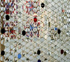 Amazing curtain composed of over 1,600 vintage optometry lenses. Installation by California contemporary artist Susan Sironi at the Chouinard Art Gallery Pasadena and the Brand Library Art Gallery.