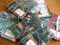 Use a set of 4 vintage paint-by-number 4-season pictures.... found they made beautiful wrapping paper for gifts.  You color-copy each painted picture onto plain 8.5″ x 11″ paper, the perfect size for CD cases, wrapped and tied up with Divine Twine and tagged with vintage gummed canning labels. (copied from website)