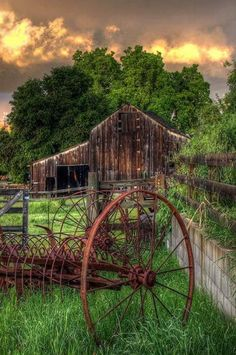 Old barn.  The hayrack in the foreground is just like the one my brother was riding when the horses shied and he was thrown off the seat. My brother fell under the rakes which cut the top of his head requiring many stitches.  Even in the 1950s, farm life had plenty of hazards. We five siblings all survived into adulthood.