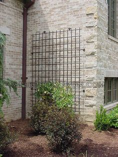 large scale decorative iron trellis for a house wall