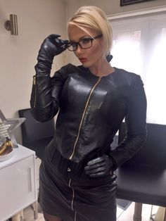 A beautiful blonde wearing glasses in black leather...sigh