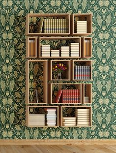 Suspended shelves hung in a rectangular pattern. Heraldic Mielie pattern over bookshelf from Quagga Fabrics & Wallpapers.
