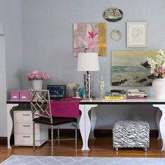 Line a wall with two identical tables for a chic symmetrical look. This work space, stationed in a living room, can be cleared of office supplies and double as a buffet or bar for hosting parties.