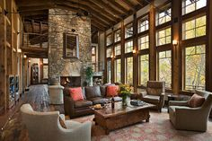 roger wade studio interior photography of timber frame home living room toward fireplace and wall of windows looking out to fall color, priv.