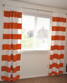 diy painted striped orange and white curtains.Yes, I am redoing my living, and yes, I am doing orange striped curtains (not the same orange) and yes, it is bold.  And yes, I am scared.  lol
