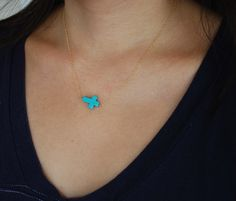 Horizontal Sideways Turquoise Cross Necklace in gold or silver. $23.00, via Etsy.