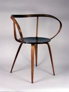 Rare George Nelson Pretzel Chair for Herman Miller  USA  1950's  Rare design by Nelson for Herman Miller. Slender curvaceous bent wood arm rises from beneath the seat to define the armrest and seat back. Masterful use of materials later reflected in Norman Churner's mass market design.