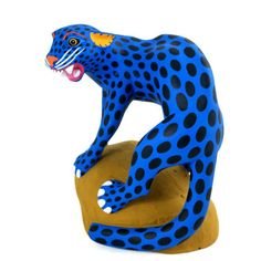 Luis Pablo is considered one of the top wood carving artists  in Oaxaca. He is known for his realistic carvings and contemporary use of color and painting techniques.     The expression of this fierce panther on boulder is simply spectacular! Luis Pablo is one of the few Oaxacan carvers that does everything himself...he designs, carves and paints all of his pieces.