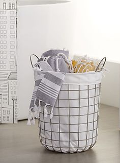 """Exclusively from Simons Maison     A modern, multi-use metal basket in this season's Scandinavian Comfort style.    Removable fabric   2 practical handles   Height: 16"""""""