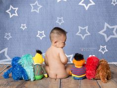 First birthday photo shoot. Sesame Street toys, tushie shot with toys, Long Island photography