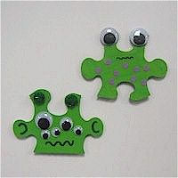Aliens.... large puzzle pieces.  put a backing on it and some lanyard for a necklace.... for the boys!