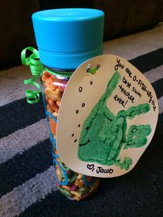 """Swim teacher gift. Water bottle filled with gold fish crackers and the child's handprint made to look like a fish that says """"You are o-FISH-ally the best swim teacher ever!"""""""