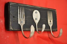 Made with vintage forks & spoon on recycled wood.