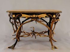 Elaborately Crafted Antler Desk, circa 1890   From a unique collection of antique and modern desks and writing tables at https://www.1stdibs.com/furniture/tables/desks-writing-tables/