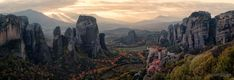 A panoramic view of the Monastery of Rousanou looking out onto the enormous sandstone pillars of the Meteora area of Greece.