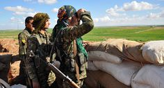 Russia's Kurdish Gambit: US Ally in Syria Takes Moscow's Side:  Members of the Kurdish People's Protection Units (YPG) monitor the positions of Islamic State (IS) group in the Syrian town of Ras al-Ain, close to the Turkish border on March 13, 2015