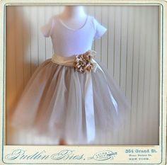 Champagne fluffy tutu with satin ribboned waist. Featured in Martha Stewart Weddings Magazine Spring 2011.. $78.00, via Etsy.
