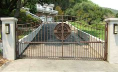This gate demonstrates our ability to have the bottom of the gate follow the slope of the driveway. This can be tricky and often requires swinging the gate out if the driveway slopes up. This job shows the use of DKS 6002 post-mounted gate operators