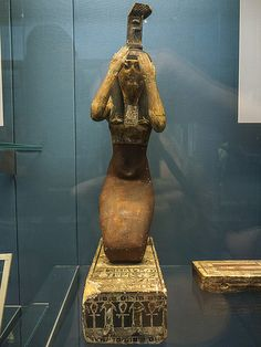 Wooden statuette of Nephthys mourning. Early Ptolemaic period (c.300 BC), Egypt. British Museum (EA 60859).