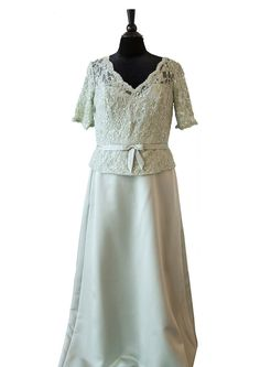 This beautiful Satin A-line gown has a short sleeved lace bodice with a romantic slightly scalloped V-neckline. Shown in Sage Green.
