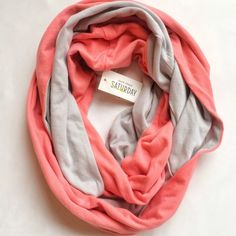 Kate Spade Saturday Two Sided Loop Scarf Pale gray on one side and neon coral color on the other side.  Very soft, 100% cotton infinity/loop scarf.  Brand new with tags! kate spade Accessories Scarves & Wraps
