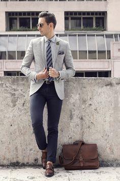 Grey blazer blue trousers,but with socks!