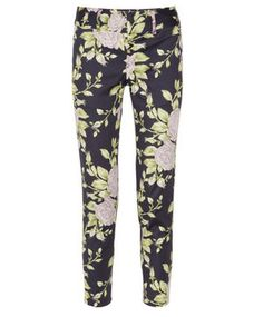 Printed with sage and pale-purple flowers, rag & bone's navy 'Malin' skinny pants exude vintage charm. Wear this sleek cotton-blend pair to anchor slouchy sweaters and silky shirts.