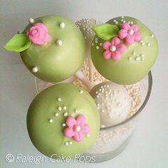 sage cake pops with tiny pink flowers