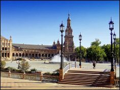 """The Plaza de España (""""Spain Square"""", in English) is a plaza located in the Parque de María Luisa (Maria Luisa Park), in Seville, Spain built in 1928 for the Ibero-American Exposition of 1929. It is a landmark example of the Renaissance Revival style  Barcelona Airport Private Arrival Transfer Excursions in Barcelona Vacations in Barcelona Sightseeing tours, airport transfers, taxi, interpreter and your personal guide in Bar"""