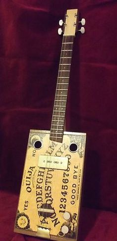 Ouija inspired Cigar Box Guitar. Ok I gotta have one of these. Aunt Ema, I'm comin' a callin' darlin'...... ~Rooster