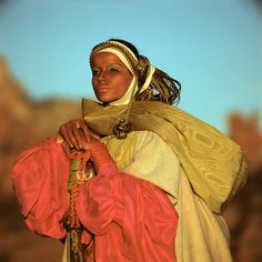 July 1968, Vogue featuring Veruschka by Franco Rubartelli wearing Giorgio di Sant'Angelo. Sant'Angelo became a celebrated sensation. Inspired, he debuted his first clothing collection less than a year later, a colorful homage to the styles of Gypsies and peasants that hearkened the wraps and tunics he created in the desert.
