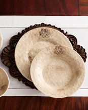 """Pretty    http://www.neimanmarcus.com  """"Crest"""" Dinnerware   Handcrafted in Italy of glazed clay. Dishwasher safe. The 16-piece service includes four each of dinner and salad plates, cereal bowls, and mugs, Mug holds 9 ounces, Serving bowl, 12.5""""Dia, Oval platter, 17.75"""" x 13"""", Hand-carved wooden charger, 17"""" x 14""""."""