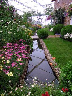 0cf4fb4b911086 Cottage garden flower bed - what a beautiful back yard Garden Stream