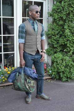 (Sabir M. Peele  Leather Olive Green Neumok Wingtips by Allen Edmonds  Tweed Waist Coat by J.Crew  Hemp tie by Dolbeau  Quilted Bomber Jacket by Polo (Ralph Lauren)  Camo Bag by Cock Pit USA  Custom Shirt by Blank Label